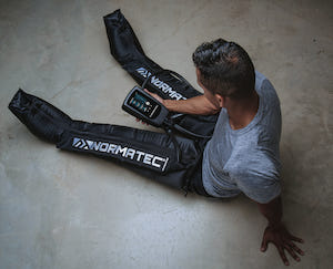 Photo of client wearing NormaTec device
